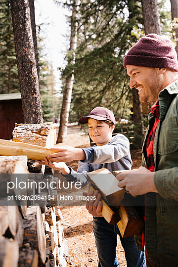 Father and son gathering firewood - p1192m2094154 by Hero Images