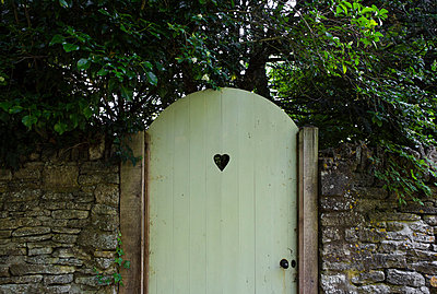 Garden gate with heart-shaped hole - p1057m916774 by Stephen Shepherd