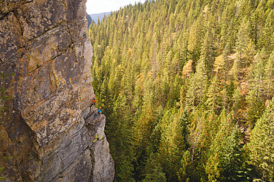 Determined mountaineer climbing the rocky cliff - p1315m1565295 by Wavebreak