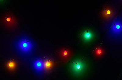 Colorful glowing string lights - p300m2202463 by Borislav Zhuykov