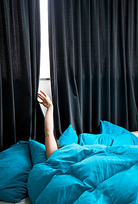 Bedroom curtain pulled open a little - p1231m1041950 by Iris Loonen
