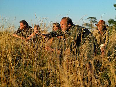 People in a safari - p429m1132179 by Ghislain & Marie David de Lossy