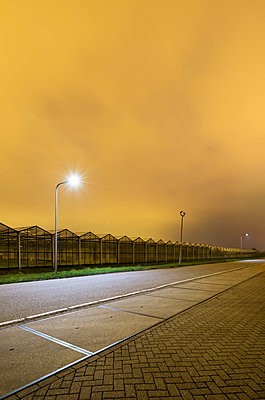 Greenhouse at night, in Westland,  area with the highest concentration of greenhouses in Netherlands - p429m1557418 by Mischa Keijser