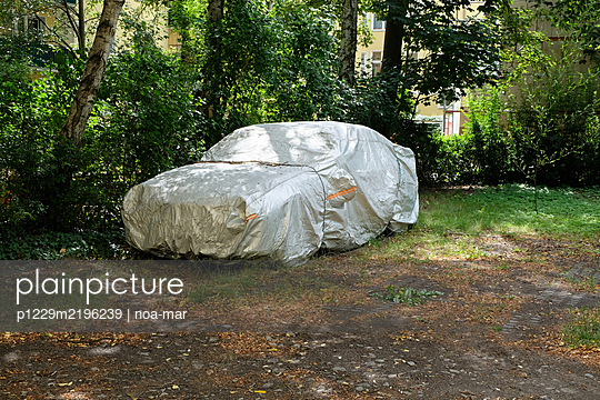 Car covered with tarpaulin - p1229m2196239 by noa-mar