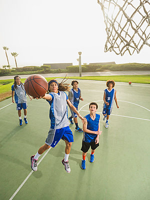 Basketball teams playing on court - p555m1415523 by Erik Isakson