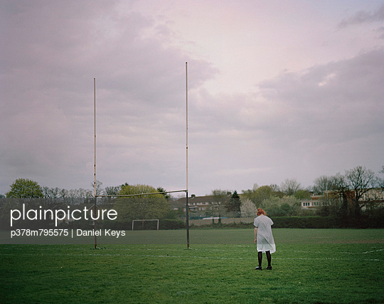 Girl on rugby pitch - p378m795575 by Daniel Keys
