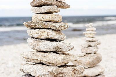 Sweden, Gotland, Faro, Cairn on beach - p352m1078968f by Mattias Nilsson