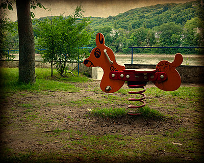 Child's wooden horse in park - p1072m829156 by Kevin Mallia