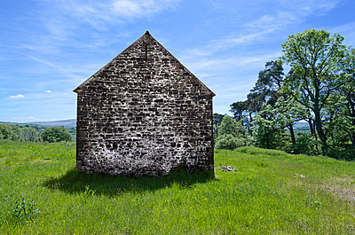 Windowless Stone Building in Countryside - p1562m2288018 by chinch gryniewicz