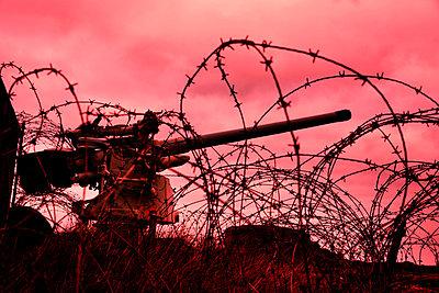 Machine gun behind barbed wire - p248m877448 by BY