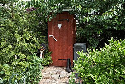 Scandinavia, Sweden, Halland, Falkenberg, View of toilet in garden - p5755536f by Jan Tove