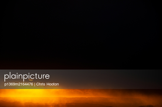 Sunset behind cloudy sky - p1369m2164476 by Chris Hooton