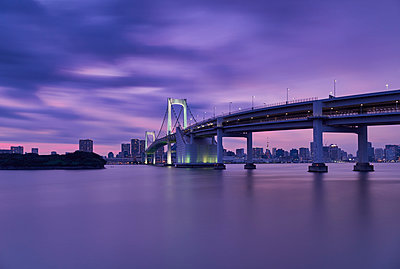 Rainbow bridge over river with Tokyo tower and sky during sunset - p1166m1530535 by Cavan Images