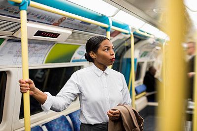 UK, London, portrait of businesswoman in underground train - p300m1581560 von Mauro Grigollo