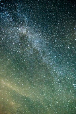 Low angle view of star field in sky at night - p1166m2060700 by Cavan Social