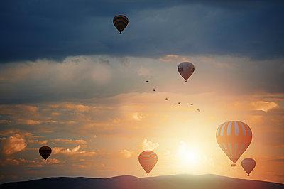 Air balloons flying over the rocks of Cappadocia - p1577m2175342 by zhenikeyev