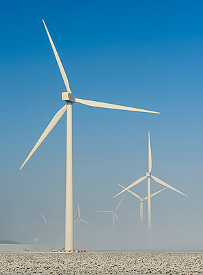 Wind turbines in snowy landscape - p429m817455 by Mischa Keijser