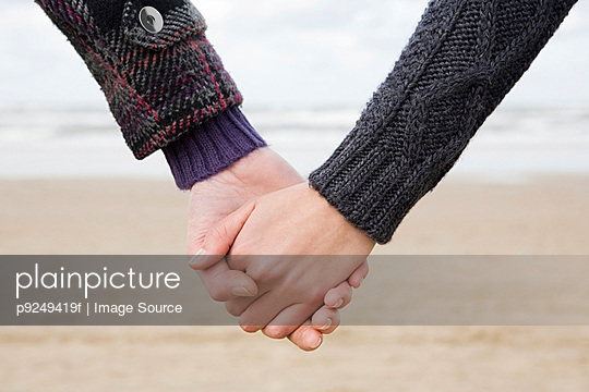 Holding hands - p9249419f by Image Source