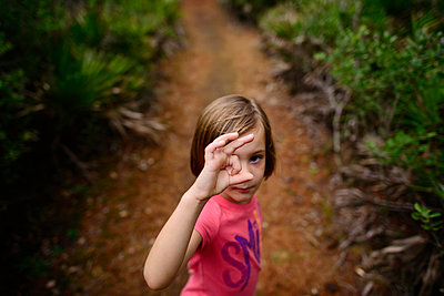 High angle portrait of girl gesturing while standing on field - p1166m1486221 by Cavan Images