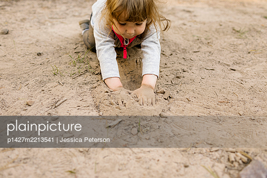 Girl (2-3) playing in sand, Wasatch Cache National Forest - p1427m2213541 by Jessica Peterson
