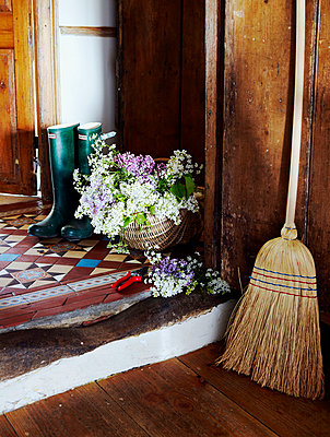 Wellington boots and cut flowers on Devon porch step - p349m789992 by Brent Darby