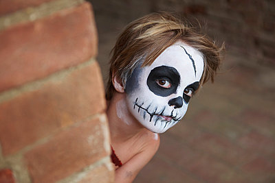 Boy with face painting of skull - p429m875748f by Ghislain & Marie David de Lossy