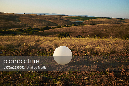 White globe in rural landscape - p378m2235852 by Andree Martis