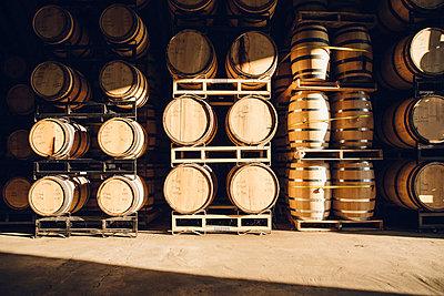 Barrels in distillery - p555m1522989 by John Fedele