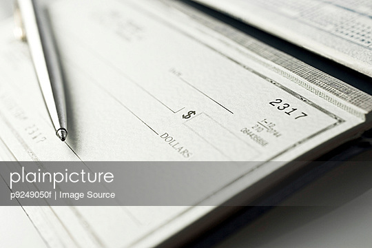 Cheque book and pen - p9249050f by Image Source
