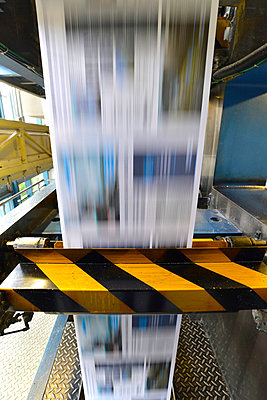 Printing of newspapers in a printing shop - p300m2213850 by lyzs