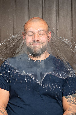 A water balloon bursting on a man's head - p1354m2277836 by Kaiser