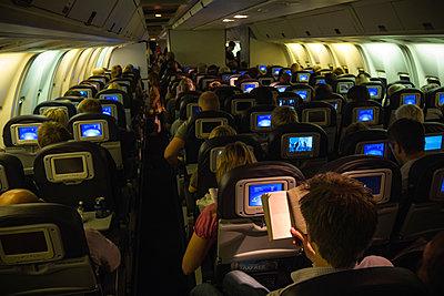 Airplane interior during night flight - p1418m1571813 by Jan Håkan Dahlström