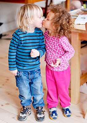 Boy and girl kissing - p312m1493508 by Rebecca Wallin