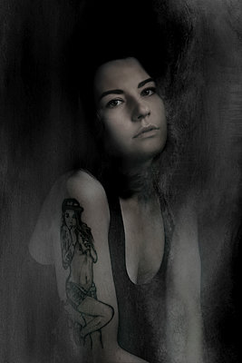 Tattooed Young Woman Portrait - p1072m1163378 by Martin Ward