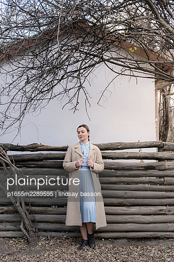 A Woman Standing By A Fence - p1655m2289595 by lindsay basson