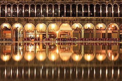 Procuratie Vecchie, the Caff̬ Quadri reflected in the high Water (Acqua alta) of St. Mark's Square, Venice, Veneto, Italy - p651m2033768 by Peter Fischer