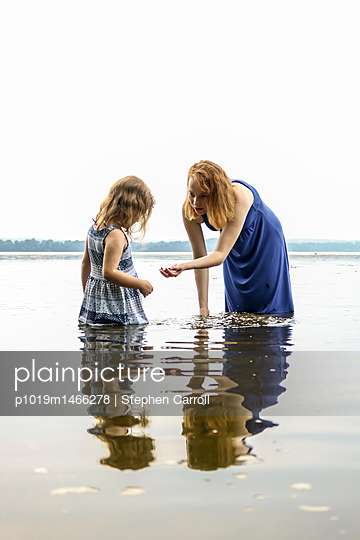 Sisters in river - p1019m1466278 by Stephen Carroll