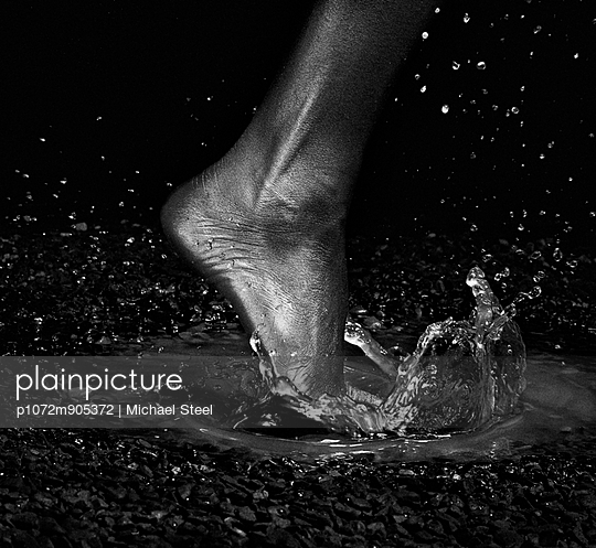 Foot splashes in water - p1072m905372 by Michael Steel