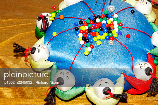 Blue pin cushion with multicoloured pins - p1302m2245032 by Richard Nixon