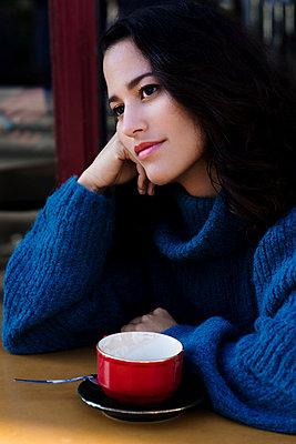 Girl in blue in a cafe - p1096m962649 by Rajkumar Singh