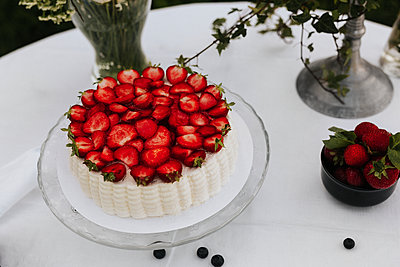 Cake with strawberries on table - p312m2191330 by Jennifer Nilsson