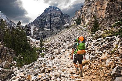 A backpacker going through rocky terrain. - p343m1184708 by Rob Hammer