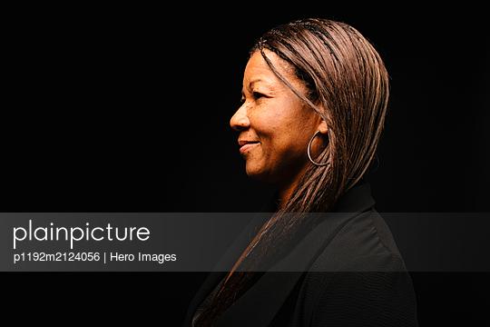 Profile portrait smiling, confident woman - p1192m2124056 by Hero Images