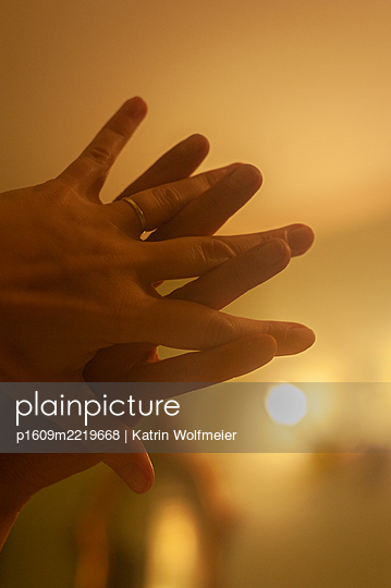 Hands touching each other tenderly - p1609m2219668 by Katrin Wolfmeier