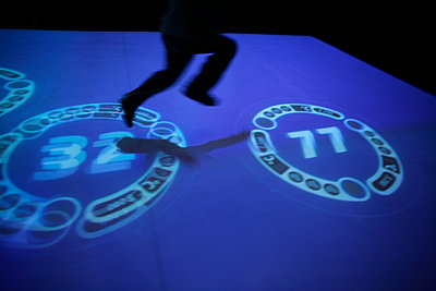Child jumping on numbers, Science festival, Cité des Sciences, Paris - p1028m2263941 by Jean Marmeisse