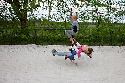 Mother and children playing - p1231m1146031 by Iris Loonen
