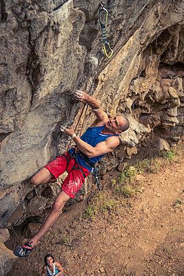 Man free climbing - p1352m1425345 by Kilian Reil