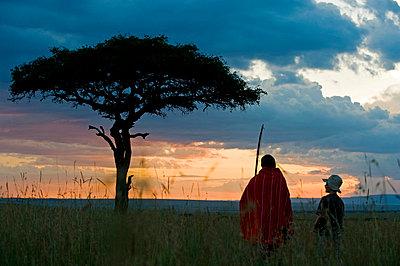 Safari guide, Salaash Ole Morompi, guiding a young boy on a bush walk during a family safari - p6521191 by John Warburton-Lee