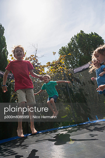 Children bouncing on trampoline