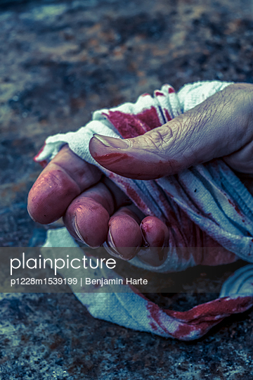 Bandaged hand and blood - p1228m1539199 by Benjamin Harte